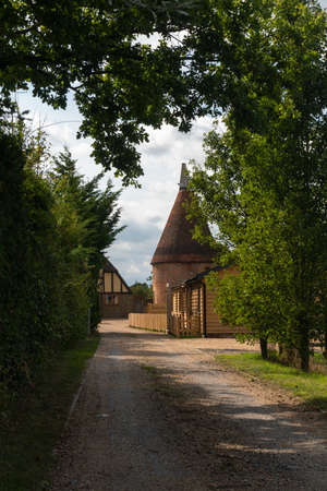 Driveway to an oasthouse in the Kent countryside, UK
