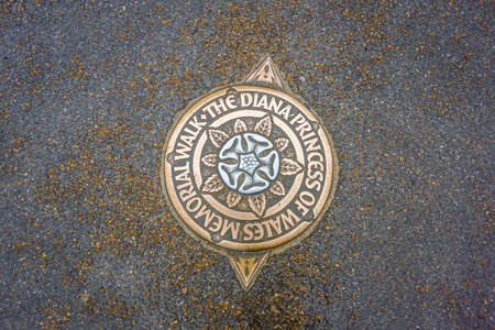 Sign on the ground marking the direction of the Princess Diana memorial walk in Hyde Park, London, UK