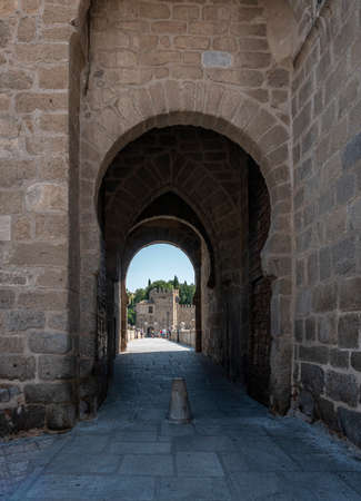 Toledo, Spain, July 2020 - Bridge of Saint Martin and city gate in the city of Toledo, Spain Editorial