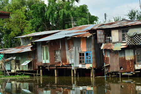 pauperism: Riverside Apartments zinc.Shows the poverty of the people. Stock Photo
