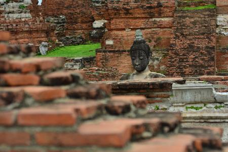 Remains of Buddha statue at Wat Mahathat photo