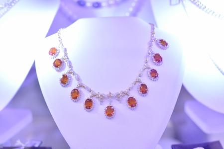 high flown: Beautiful diamond necklace orange. Stock Photo