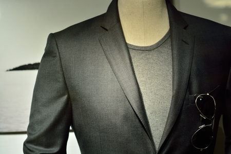 habiliment: a black man suit with glasses