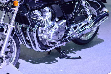 gimmick: Close-up 4-cylinder motorcycle engine.