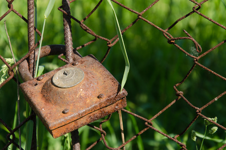 padlocked: the gates are closed on the old rusty lock Stock Photo