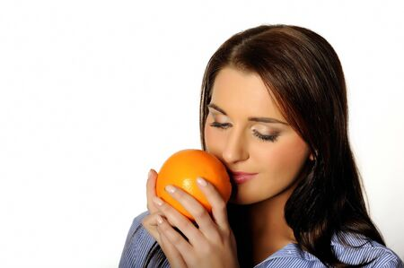 young beautiful woman with citrus orange fruit. isolated on white background. copyspace Stock Photo - 6868497