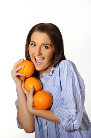 young beautiful woman with citrus orange fruit. isolated on white background Stock Photo - 6868500