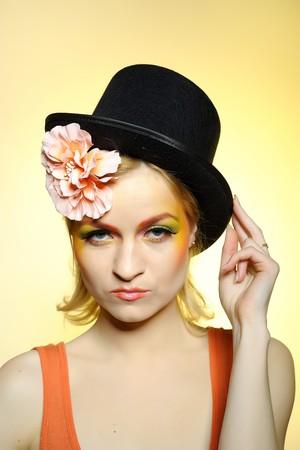 yelllow: Elegant fashion woman with creative eye make-up. yelllow background