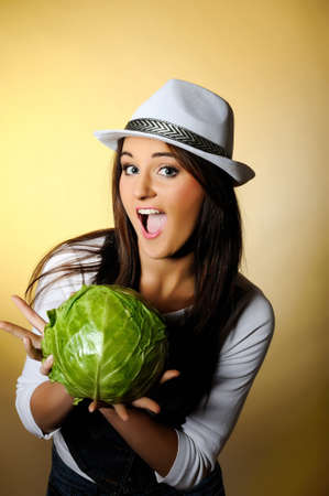 Young pretty woman with green cabbage smiling Stock Photo - 6959558