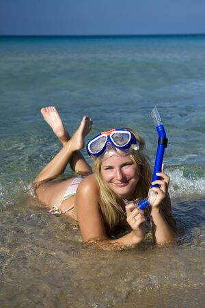 Young happy beautiful summer diving woman with swimming mask and snorkel preparing to dive in blue sea Stock Photo - 6959561