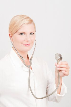 young female doctor with medical stethoscope photo