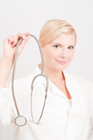 young female doctor with medical stethoscope Stock Photo - 6959568