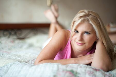 young beautiful woman relaxing on the bed  Stock Photo