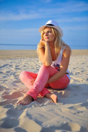 young beautiful summer girl relaxing on the beach photo