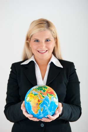 online internet presence: Young beautiful business woman with a world globe