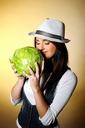 Young pretty woman with green beautiful cabbage  Stock Photo - 7058535