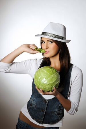Young pretty woman with green beautiful cabbage Stock Photo - 7058519