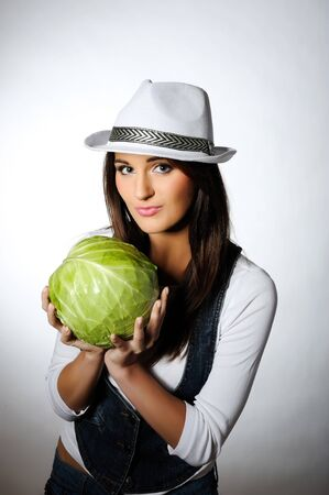 Young pretty woman with green beautiful cabbage  Stock Photo - 7058537