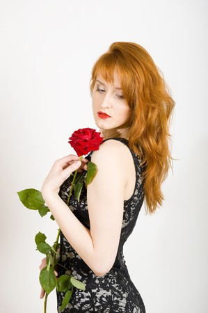 Beautiful woman with a rose Stock Photo - 7058528