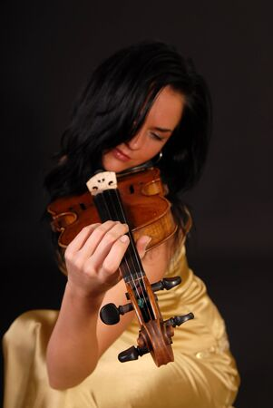 beautiful girl playing the violin photo
