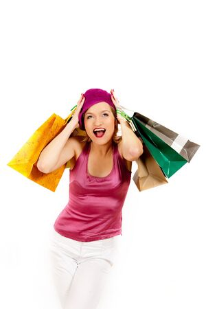 Young beautiful crazy shopping woman with bags photo