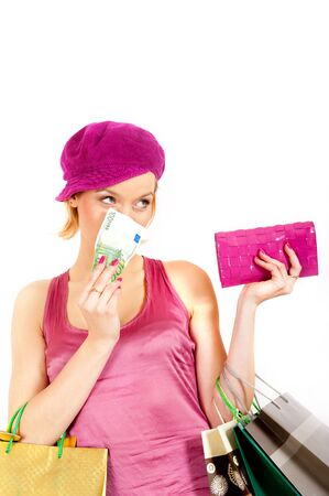 Young beautiful shopping woman with bags, vallet and money Stock Photo - 7058521