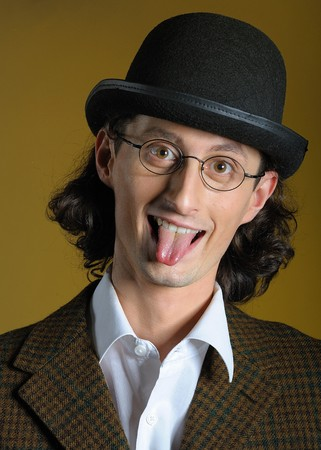 Funny man in glasses with long tongue photo