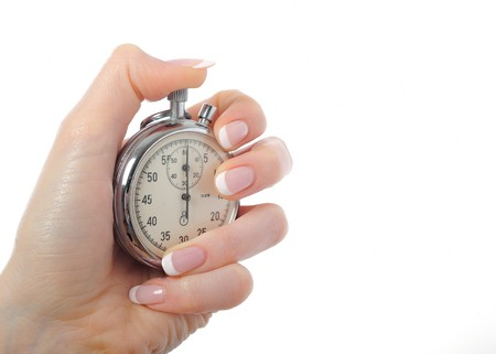 Beautiful womans hand with stop watch. isolated on white background Stock Photo - 7090969