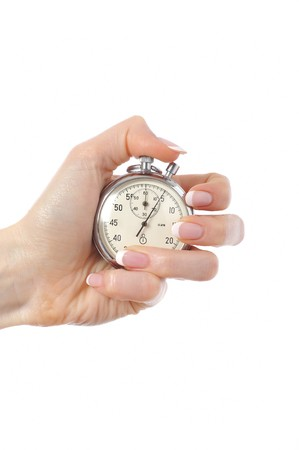 Beautiful womans hand with stop watch. isolated on white background Stock Photo