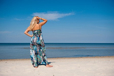 Young beautiful summer woman on the beach Stock Photo - 7089870
