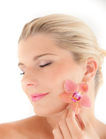 beautiful woman with healthy skin and orchid flower Stock Photo - 7089839