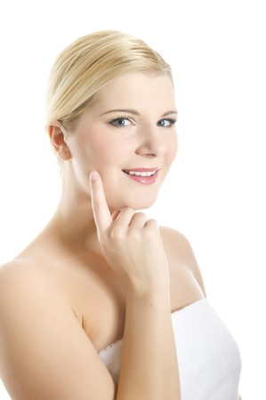 Young beautiful woman with white towel on her head touching her pure healthy skin Stock Photo - 7089831