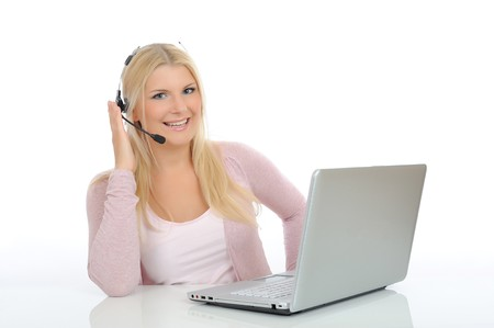 Young woman with microphone and laptop speaking. help desk assistant Stock Photo - 7281105