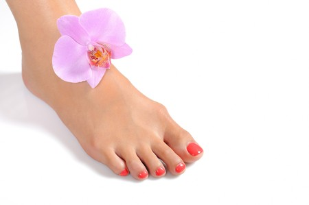foot cream: Beautiful feet leg with perfect spa pedicure on bright pink nails. white background