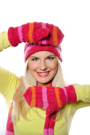 Seasonal portrait of pretty funny woman in hat and gloves smiling photo
