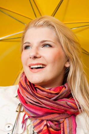 young beautiful autumn woman with yellow umbrella Stock Photo - 7365778