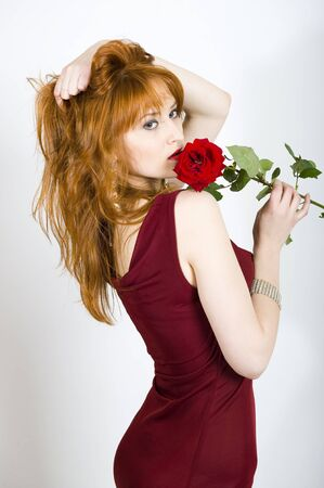 Beautiful sexy woman in red dress and rose photo