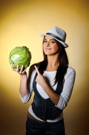 Young pretty woman with green beautiful cabbage  photo