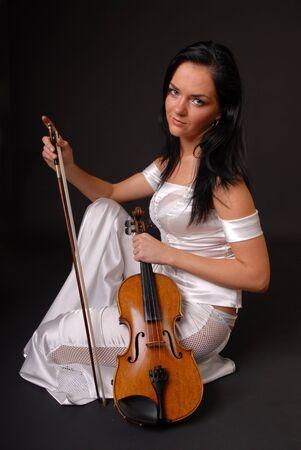 beautiful girl paying the violin photo