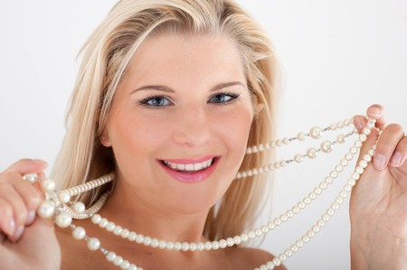 Beautiful sexy woman face with pearls. isolated on white background photo