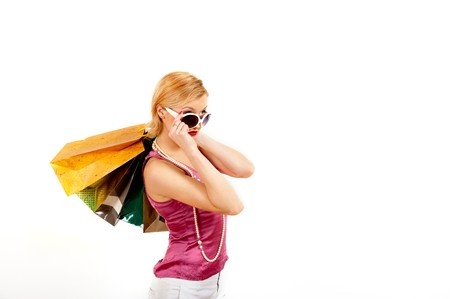 Beautiful shopping woman with lots of bags Stock Photo - 7471691