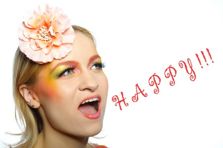 Concept of summer fashion woman with creative eye make-up in yellow and green tones screaming happy. copy-space photo