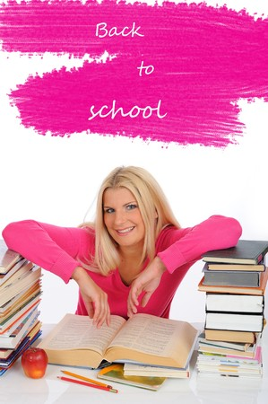 portrait of young student girl with lots of books  studing for exams photo