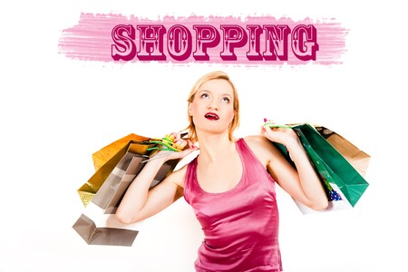 Young pretty shopping woman with lots of bags . creative design photo