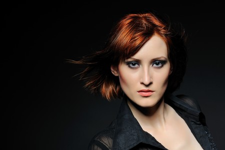 Beauty portrait of pretty woman with short fashion bob hairstyle. black background photo