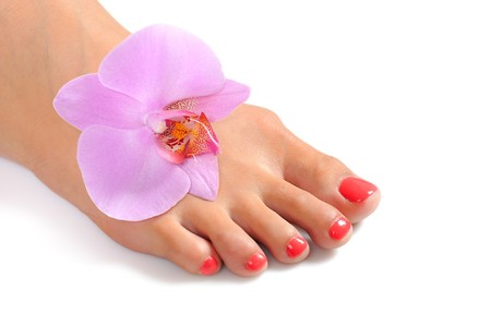 Beautiful feet leg with perfect spa pedicure on bright pink nails. white background Stock Photo - 7555614