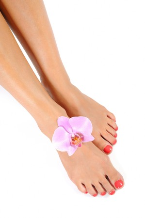 Beautiful feet leg with perfect spa pedicure on bright pink nails. white background Stock Photo - 7555615