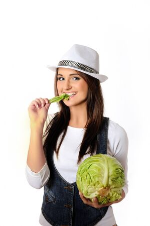 Young pretty woman with green beautiful cabbage . isolated on white background photo