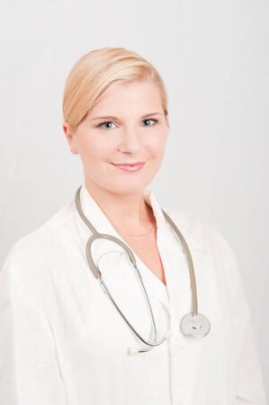 Beautiful female doctor in white medical uniform and stethoscope Stock Photo - 7722290