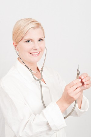 Beautiful female doctor in white medical uniform and stethoscope Stock Photo - 7722064